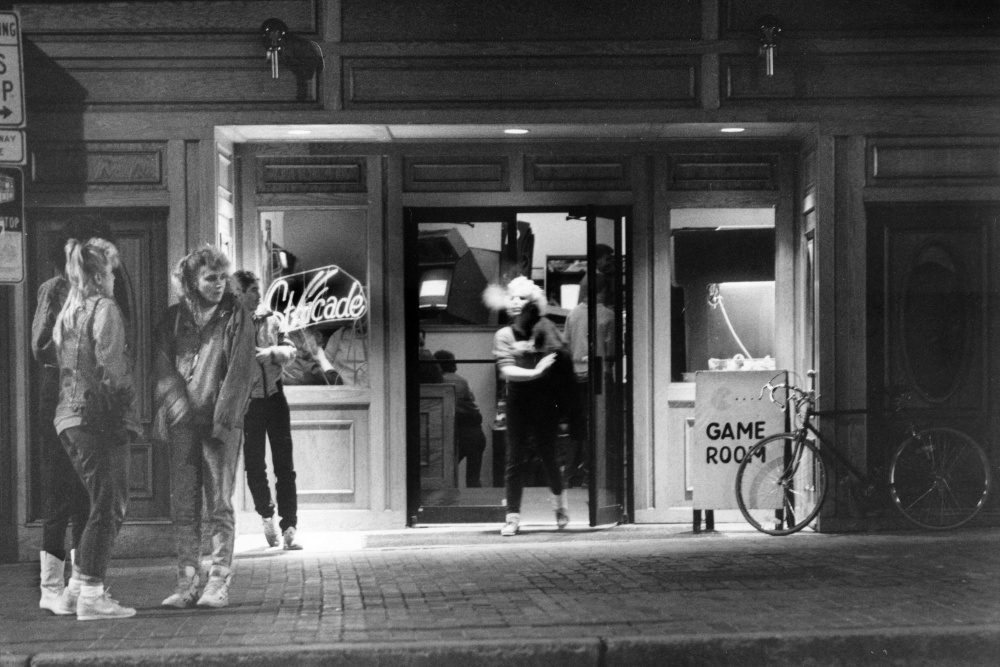 "Young people gather outside Starcade, a video-game parlor on Portland's Congress Street, in 1988. Thirty years ago, the city was ""sort of a rough-and-tumble wharf town"" in which troubled youths sometimes lived on the streets."