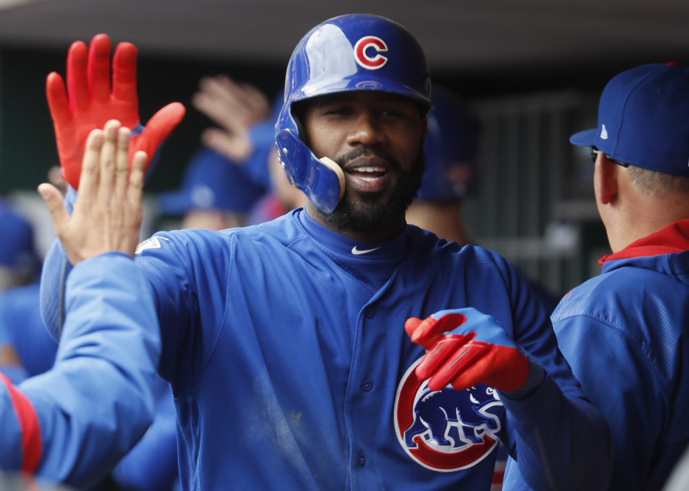 Jason Heyward of the Chicago Cubs celebrates in the dugout after hitting a three-run homer off Cincinnati Reds reliever Lisalverto Bonilla in the sixth inning of a 12-8 win by the Cubs at Cincinnati on Saturday.