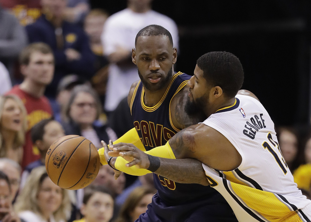 Cleveland's LeBron James is defended by Indiana's Paul George during the second half of the Cavaliers' 106-102 in Game 4 of their first-round playoff series Sunday in Indianapolis. Cleveland swept the series 4-0.