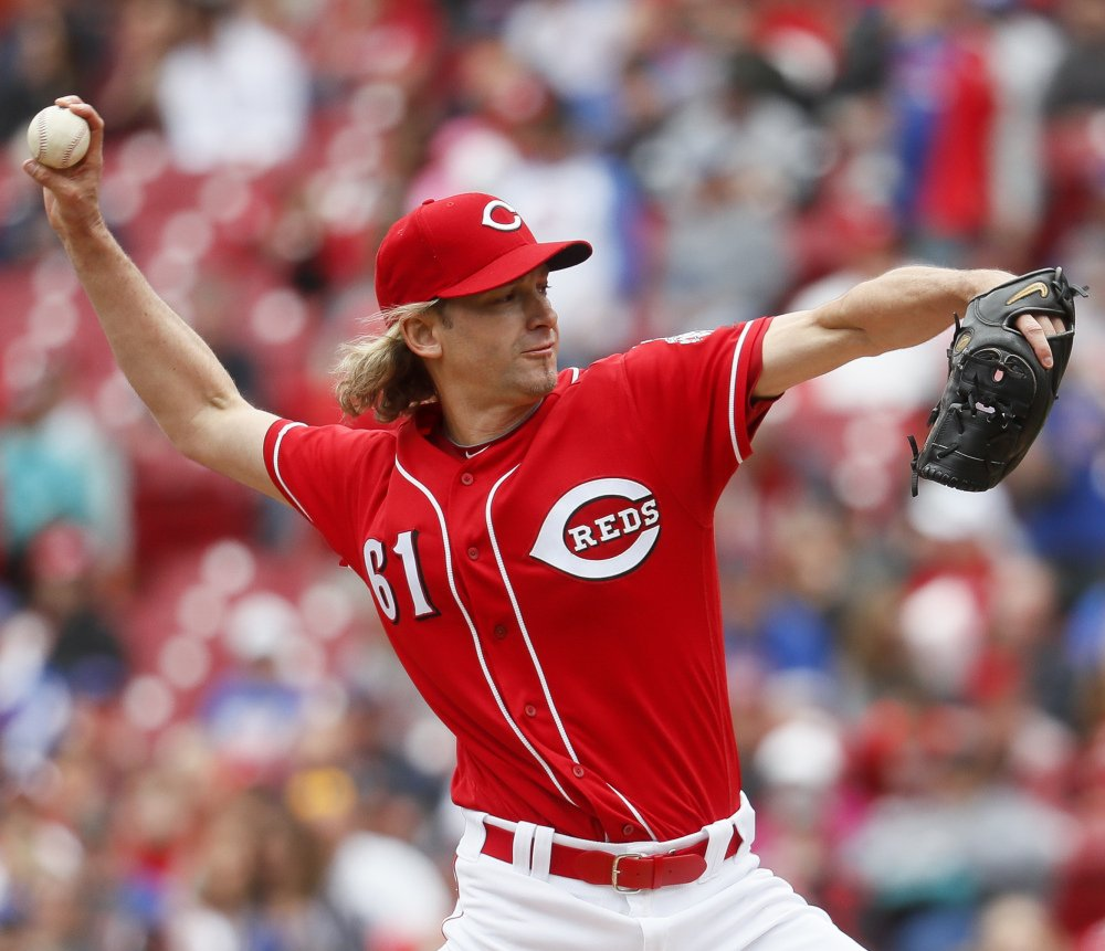 Cincinnati starting pitcher Bronson Arroyo pitched six innings, allowing two runs on three hits and the Reds beat the Cubs 7-5  in Cincinnati.