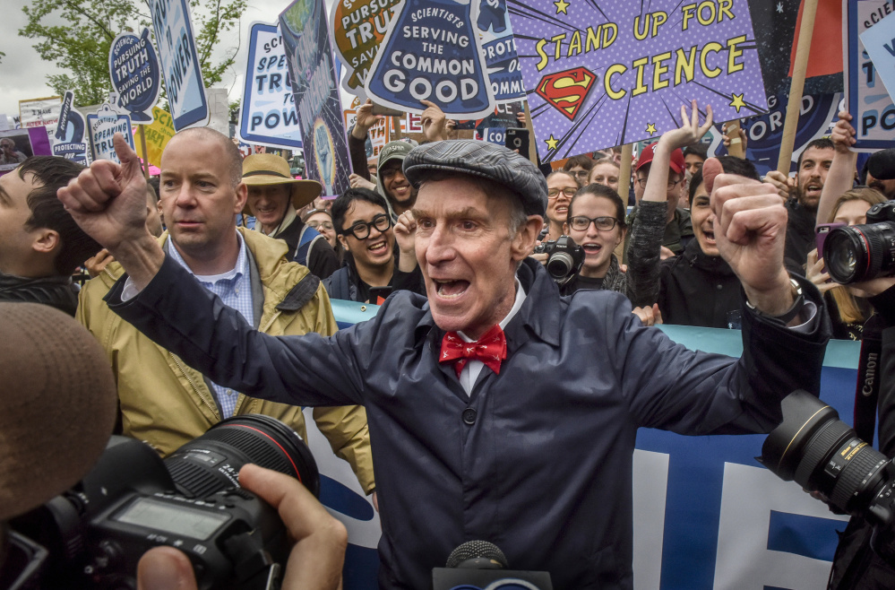 Bill Nye riles up the crowd as he takes his place at the head of the March for Science in Washington on Saturday.
