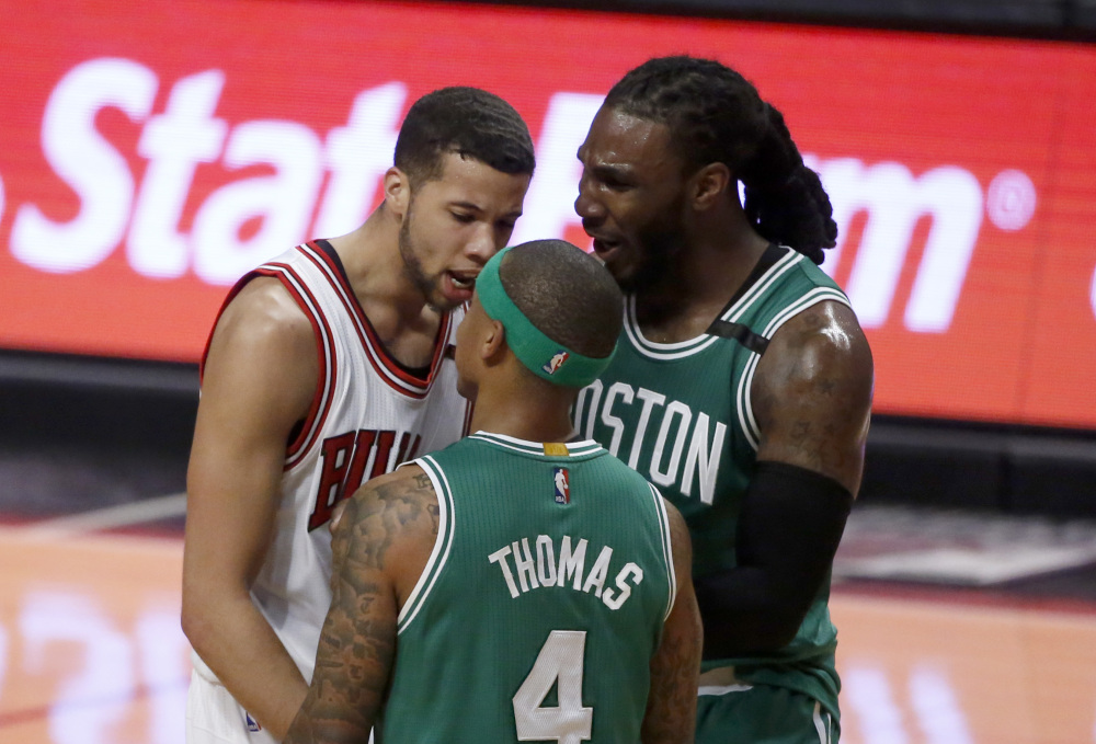 Chicago's Michael Carter-Williams, left, has words with Boston's Isaiah Thomas as Jae Crowder comes between the pair during the second half. Thomas was assessed a technical foul.