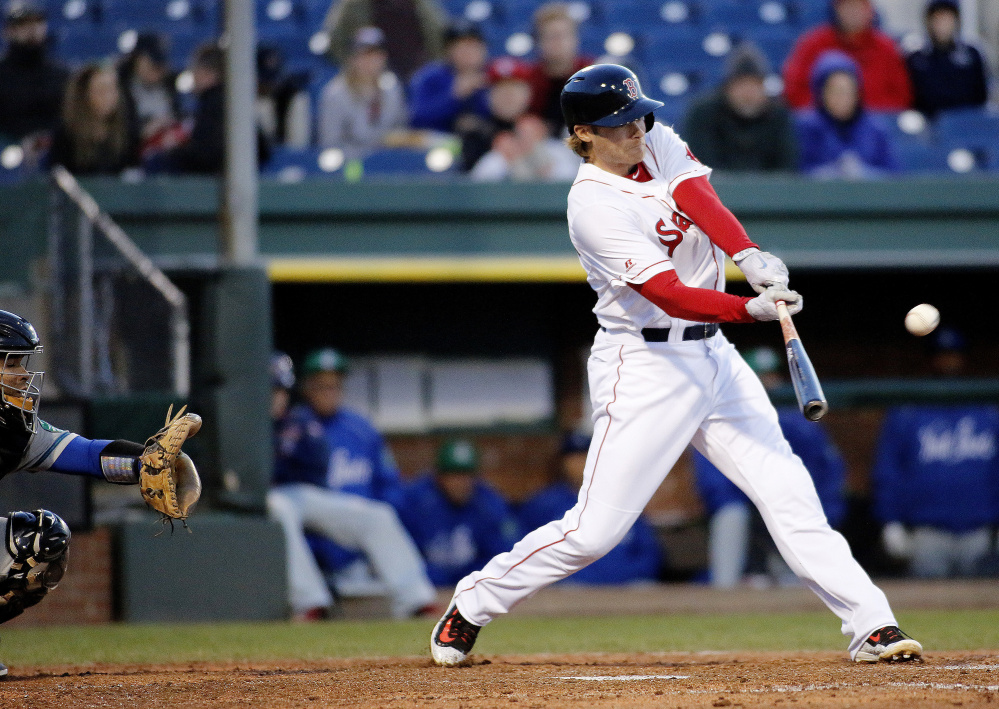 Josh Rutledge of the Boston Red Sox, on a rehab assignment in Portland, flies out to centerfield with two runners on and no outs in the bottom of the sixth inning Monday night. Rutledge went 0-for-3 with a walk.