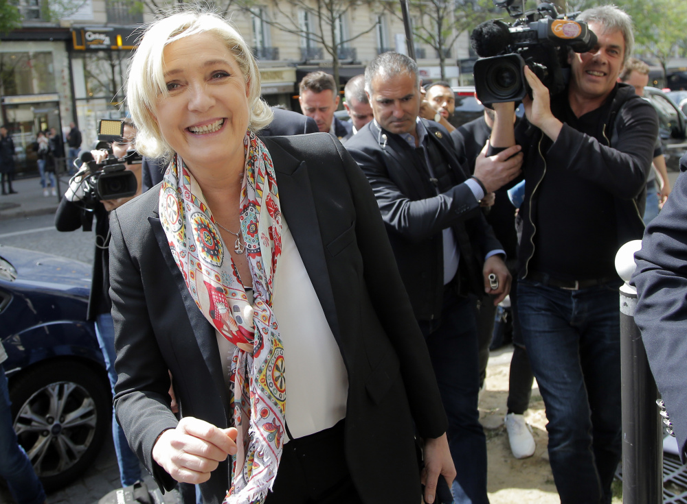 French far-right leader and candidate in the presidential election Marine Le Pen smiles after getting a haircut in Paris on Monday. Le Pen advanced in Sunday's first-round vote.