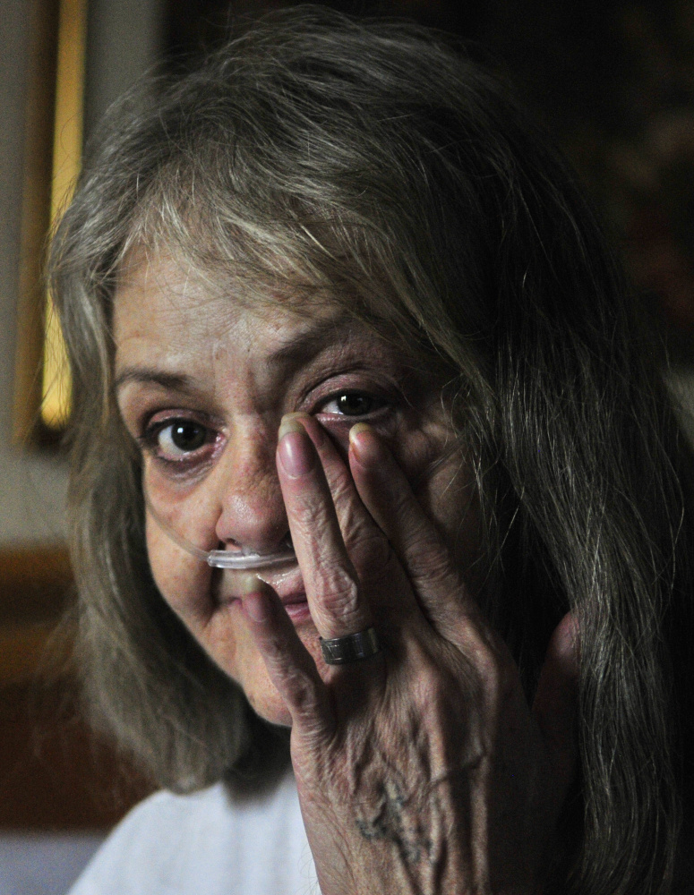 During an interview in the Augusta Super 8 motel Tuesday, Judith Catlin wipes away a tear as she talks about the fire that destroyed her home at 94 Mount Vernon Ave. in Augusta.