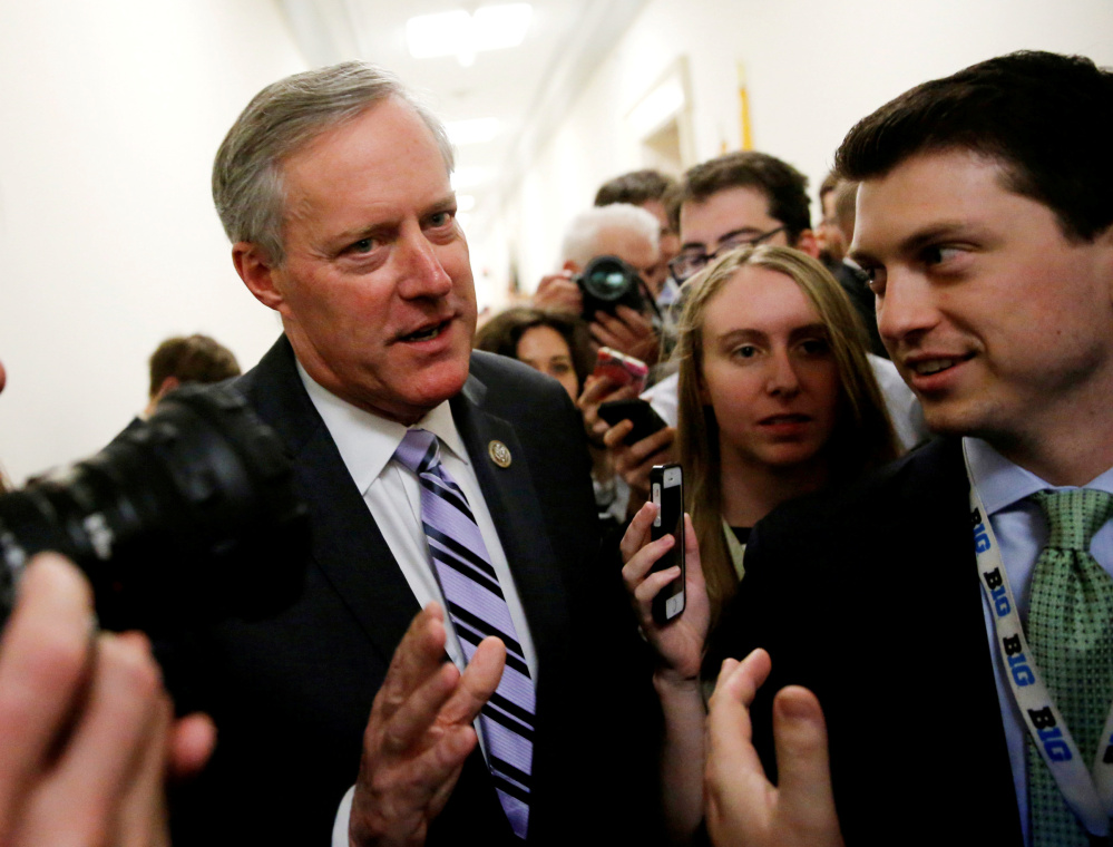 House Freedom Caucus Chairman Mark Meadows, left, is one of several conservative Republicans working with moderate members to craft a health-care bill. Reuters/Jonathan Ernst
