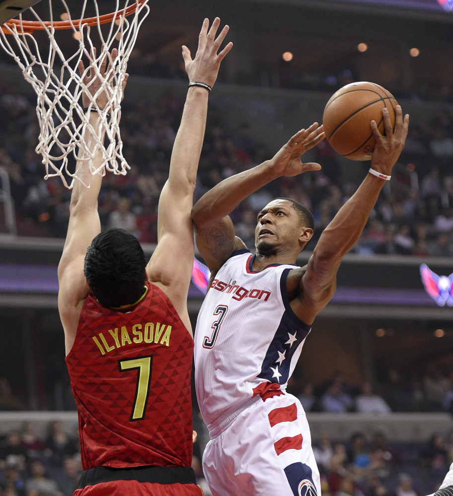 Bradley Beal of the Washington Wizards drives to the basket Wednesday night against Ehsan Ilyasova of the Atlanta Hawks during the first half of the Wizards' 103-99 victory at home. Washington leads the series, 3-2.