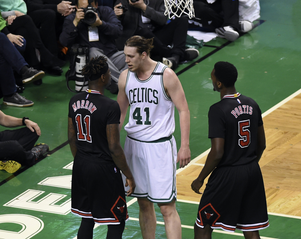 Boston center Kelly Olynyk has words with Chicago guard Anthony Morrow in the first half of Wednesday's playoff game at Boston.