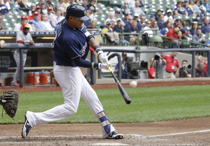 Orlando Arcia of the Brewers hits a two-run home run during the third inning of Milwaukee's 9-4 victory against the Reds at home on Wednesday.