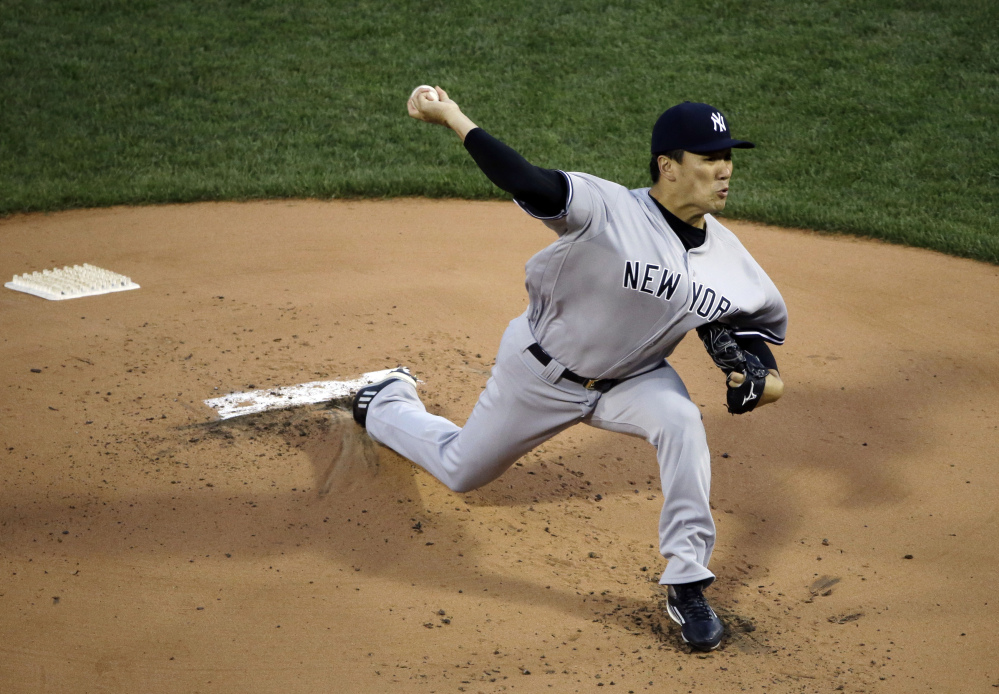 Masahiro Tanaka of the Yankees delivers to the Boston Red Sox during the first inning of Thursday's game at Fenway Park.