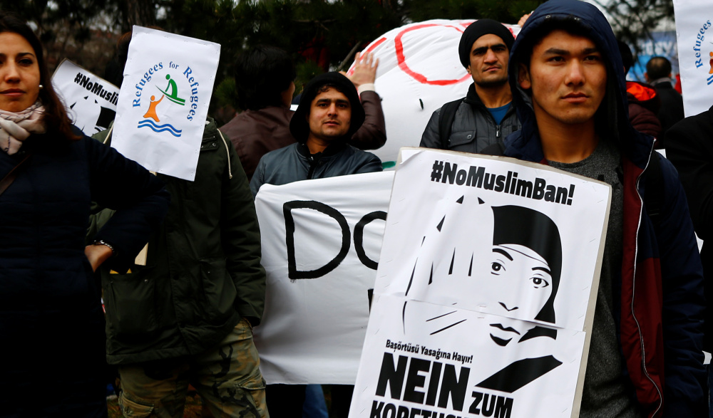 Protesters stage a demonstration against racism in Vienna, Austria, in March. Banner reads: