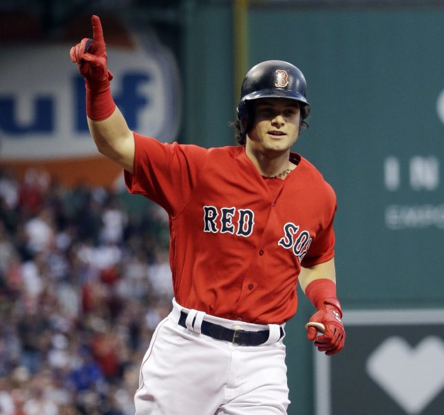 Boston's Andrew Benintendi gestures as he crosses the plate with a solo home run in the first inning Friday night against the Cubs at Fenway Park.