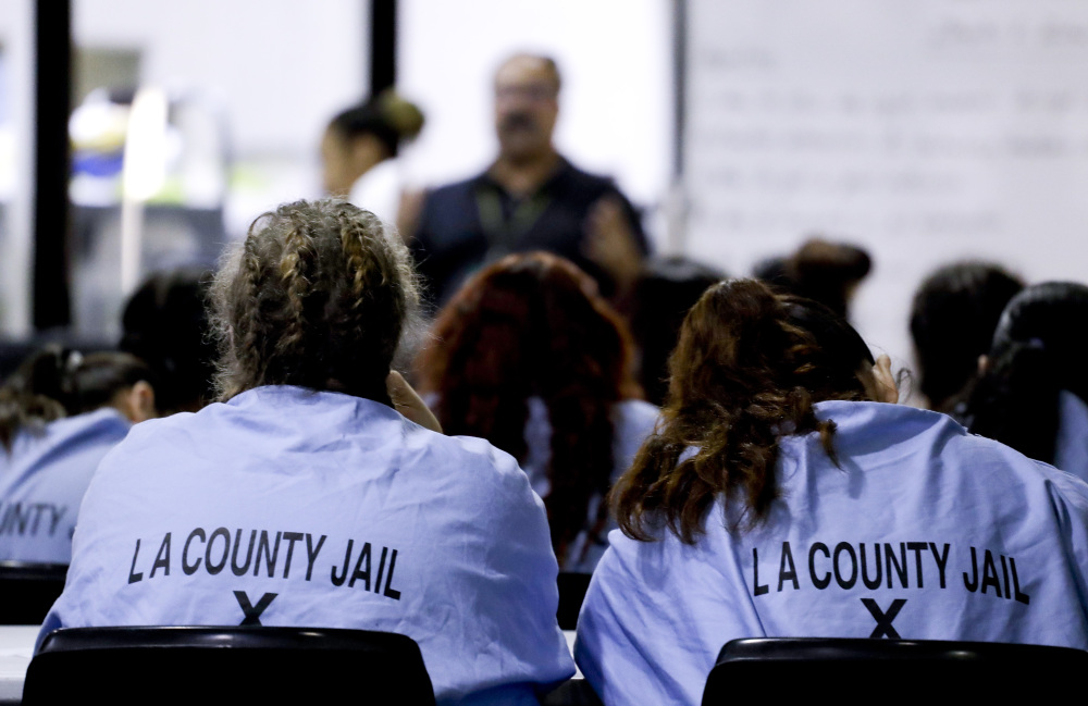 Inmates listen during a program at the Twin Towers Correctional Facility on Thursday in Los Angeles. The facility houses perhaps the world's largest group of inmates whose mental illness is attributed to drug abuse.