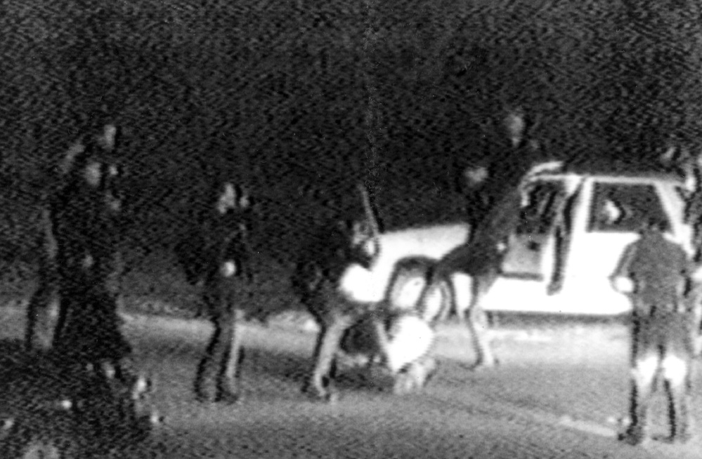This image converted from a 1991 video shows police officers beating Rodney King. King was pulled over by officers for speeding on a Los Angeles freeway.