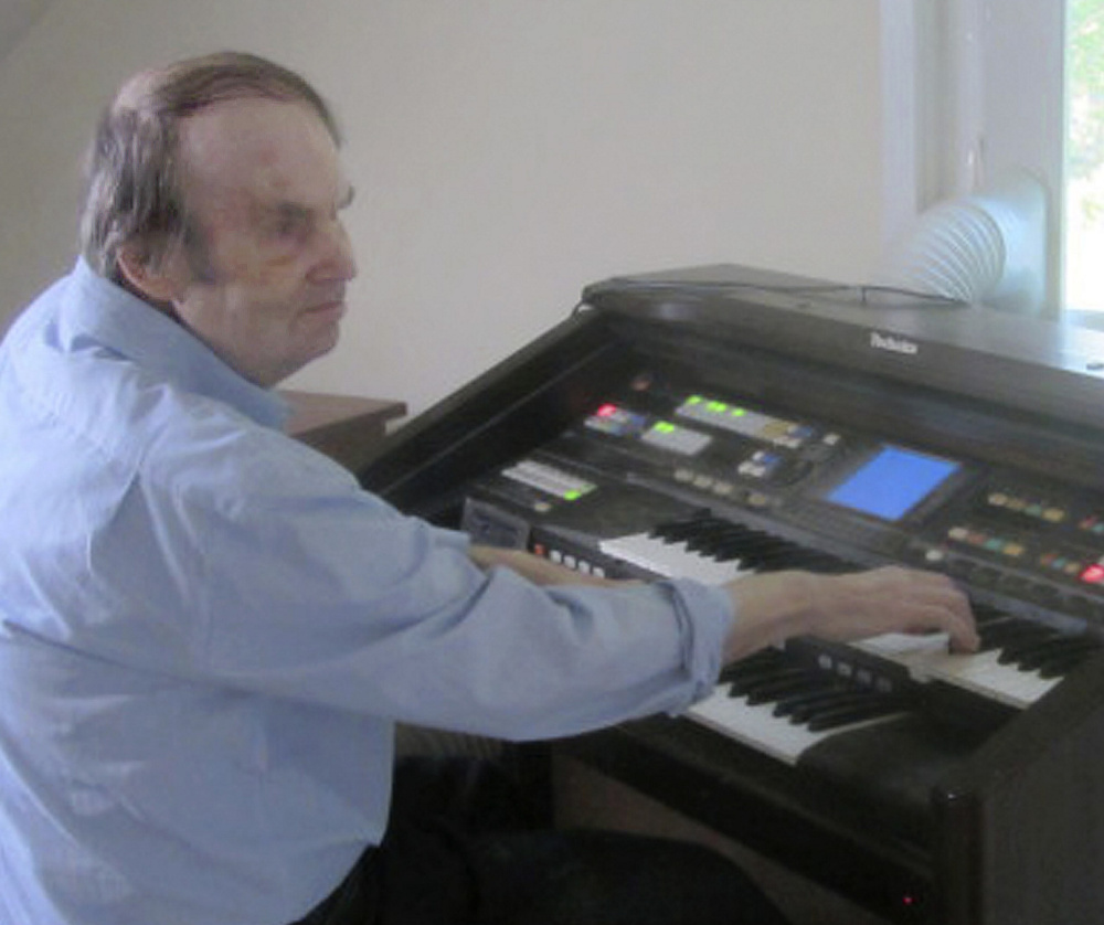 William Dean, who mastered the organ without any lessons, died in October 2016 at age 71, but the legal fight over his treatment by the state continues.
