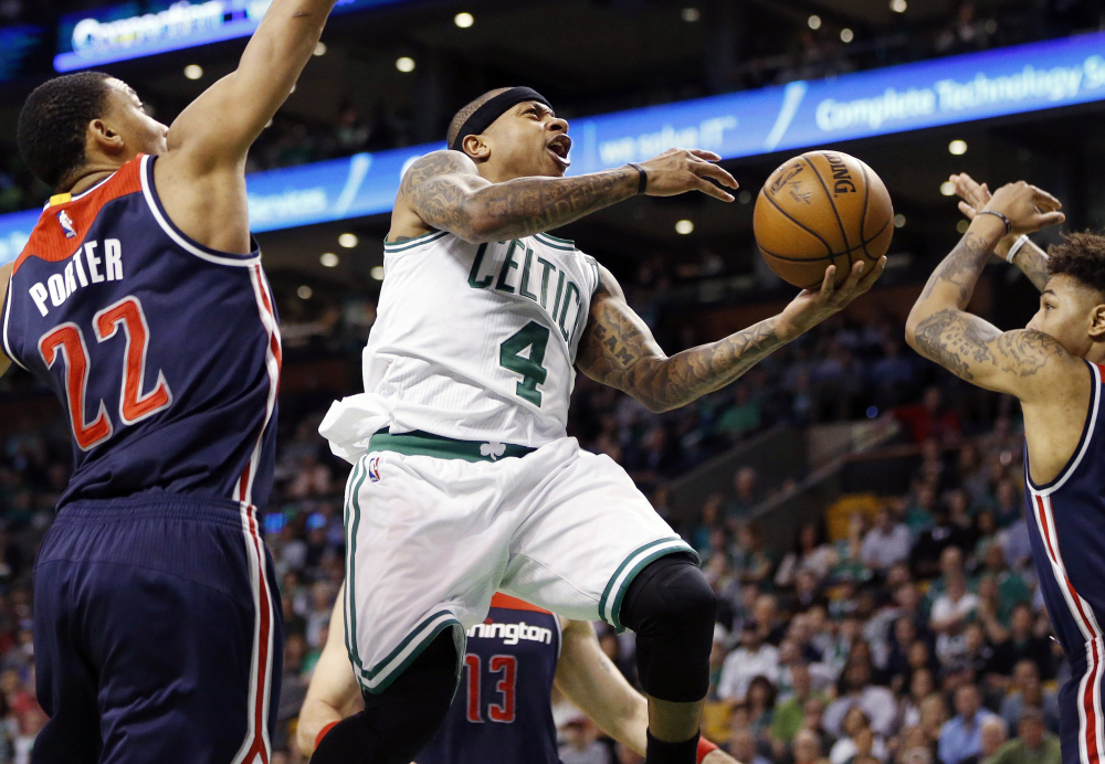 Celtics' Isaiah Thomas goes up to shoot against Washington Wizards' Otto Porter Jr. during the second quarter of a second-round NBA playoff series game in Boston in April 2017.