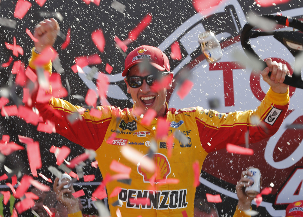 Joey Logano celebrates after his NASCAR Cup Series victory Sunday at Richmond International Raceway. (Associated Press/Steve Helber)
