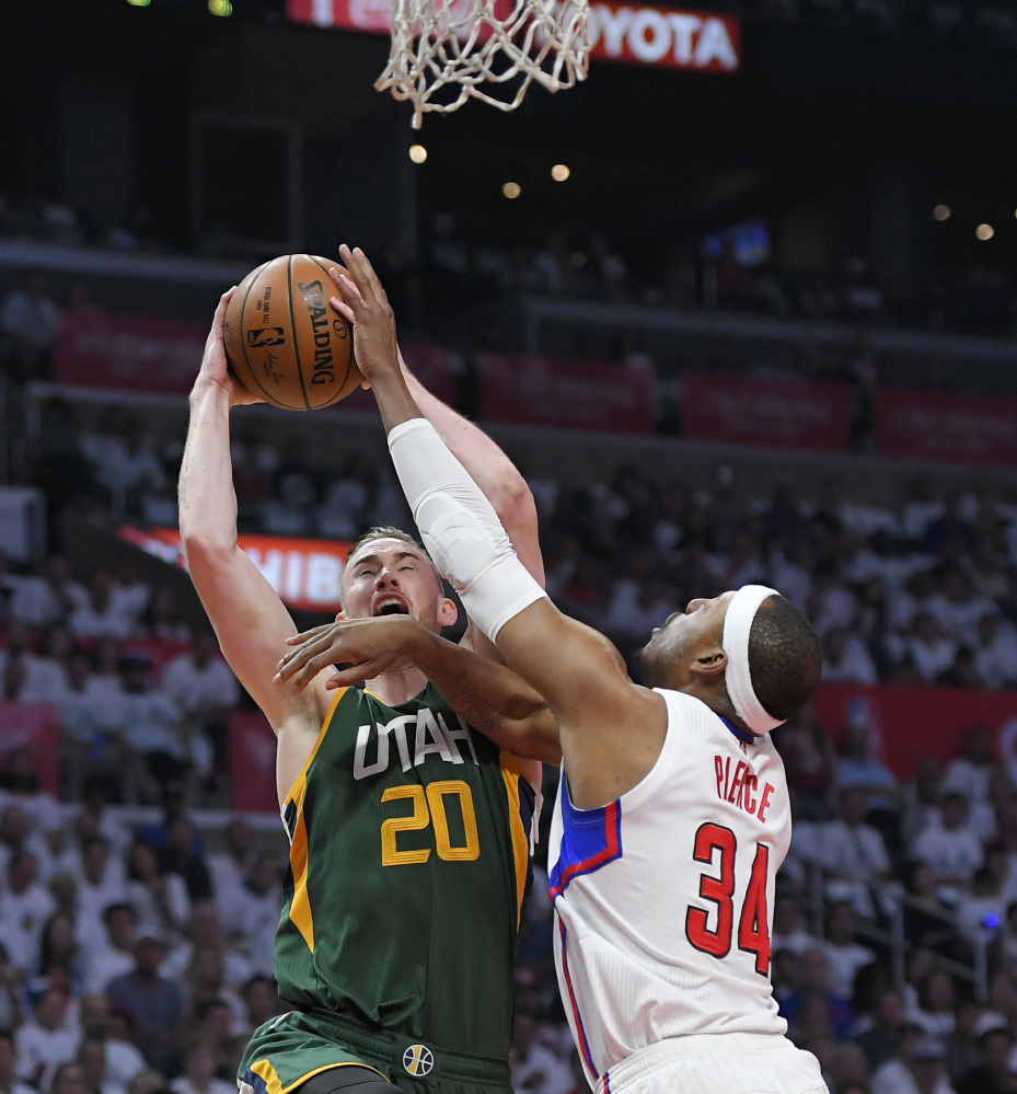 Utah forward Gordon Hayward shoots while being defended by Clippers forward Paul Pierce on Sunday in Los Angeles. The Jazz won to win the series.