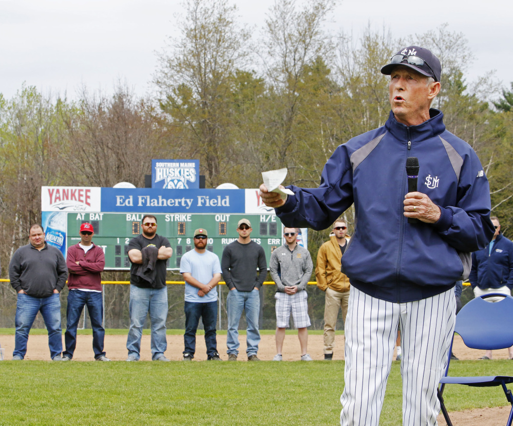 As members of his 1991 and 1997 national championship teams look on, USM Coach Ed Flaherty speaks Sunday during a ceremony in which the school's baseball field was named Ed Flaherty Field.