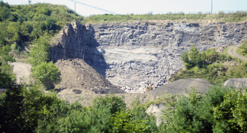 The McGee pit in Augusta is seen from east side of the Kennebec River in September 2015. Blasting at the site has provoked ongoing complaints from nearby residents.