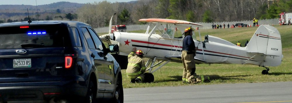 Waterville police and firefighters on the scene at the Waterville Airport on Sunday.