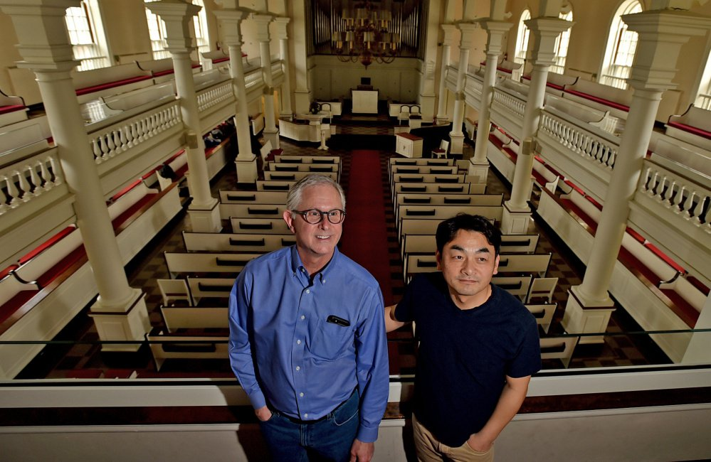 Jonathan Hailstrom, left, music professor and former conductor at Colby College, stands on Tuesday with Jinwook Park, right, current Colby College Symphony Orchestra conductor at Lorimer Chapel at Colby College in Waterville. Hailstrom said the orchestra's finale has been planned for weeks to honor Peter Ré. Park will conduct the concerts' selections.