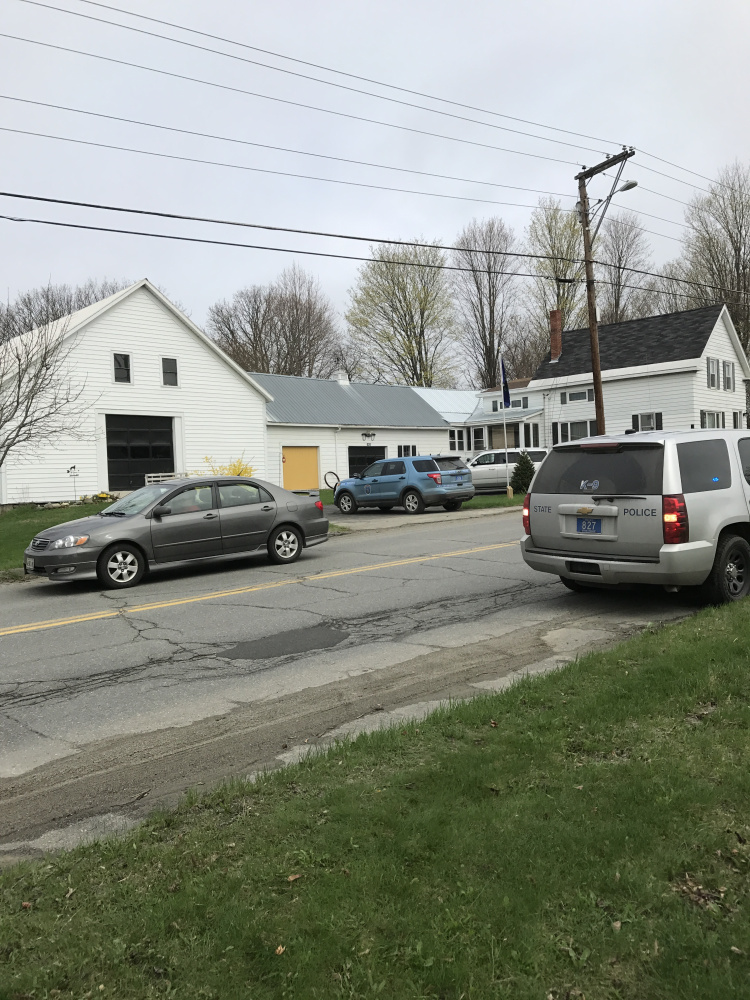 Police search the area on Benton Avenue where the final suspect in a string of car burglaries was caught Friday morning.