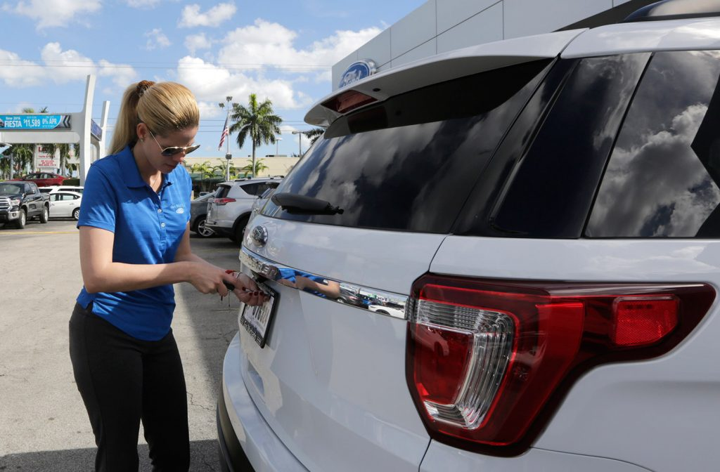 Trucks and SUVs like this 2017 Ford Explorer are still selling but dealers reported a drop in sales of passenger cars Monday for a third straight month.