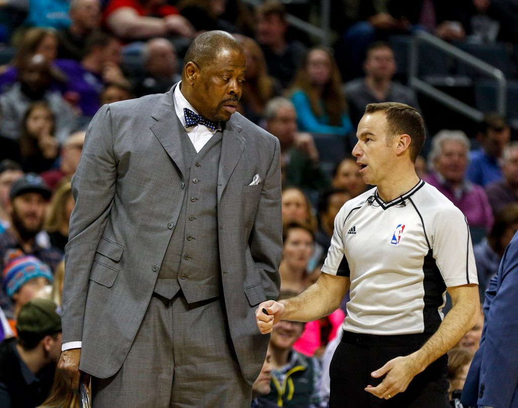 Charlotte Hornets assistant coach Patrick Ewing, left, talks to NBA referee Josh Tiven during the Jan. 28 Hornets NBA game against the Sacramento Kings. Ewing has been hired as Georgetown's men's basketball coach, more than two decades after he led the Hoyas to their only national championship.
