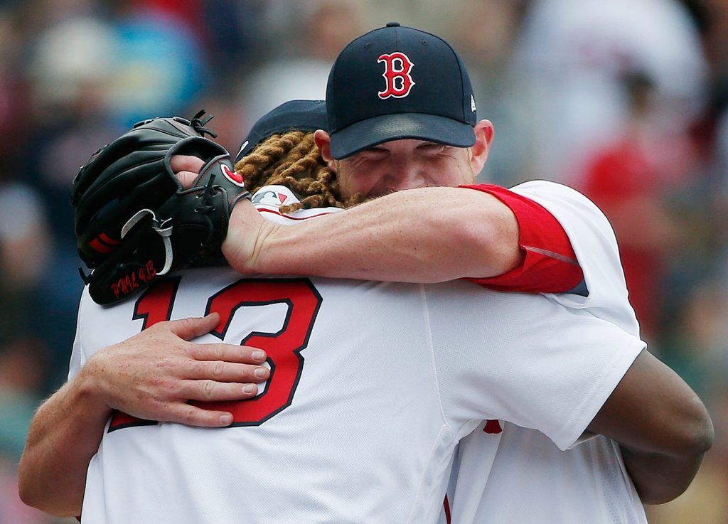 Boston Red Sox's Hanley Ramirez hugs Craig Kimbrel after the Red Sox defeated the Tampa Bay Rays 4-3 in a baseball game Monday in Boston.