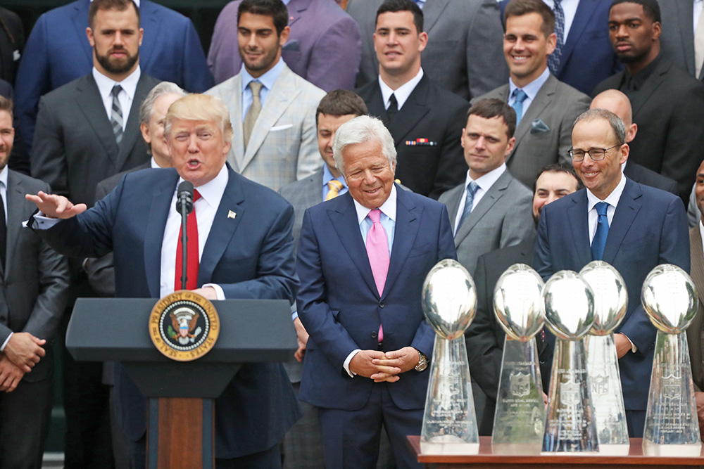 New England Patriots owner Robert Kraft, center, and team members listen as President Trump speaks during a ceremony on the South Lawn of the White House in April.