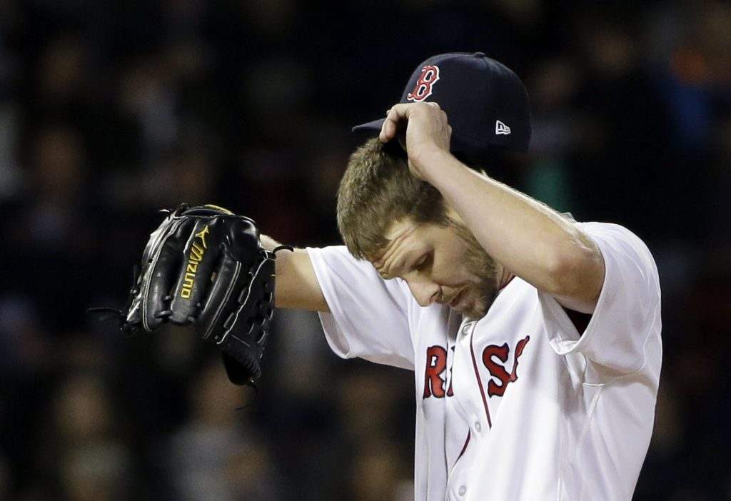 Red Sox starter Chris Sale reacts after giving up a run in the ninth inning Thursday night against the Yankees at Fenway Park.