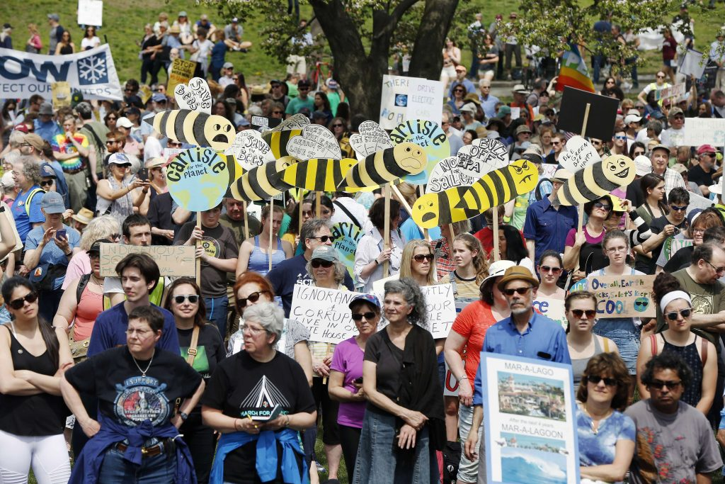 People gather for Boston's People's Climate March on Boston Common on Saturday.