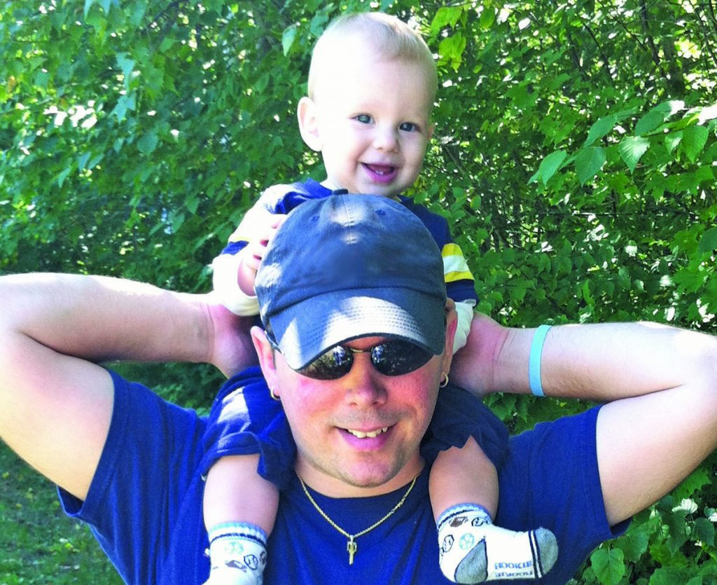 "Jake Roberts, shown with his son, Luc, is a ""master coach"" in the Maine Boys To Men ""boot camp"" for new dads."