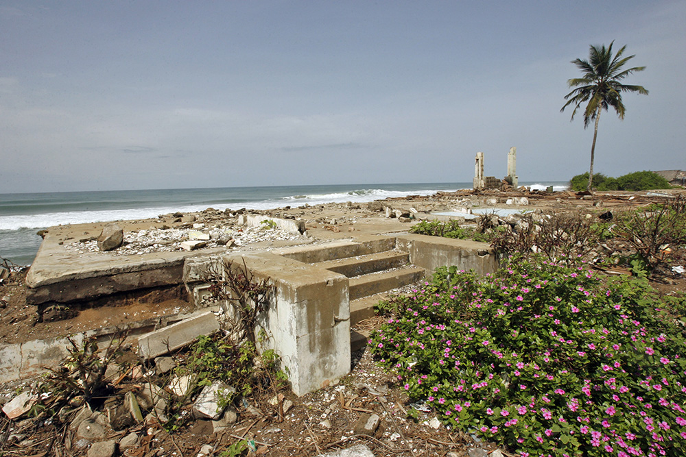 The ruins of houses destroyed by erosion line a beach in Grand-Lahou on the southern Ivory Coast. In populated coastal West Africa, rising sea levels linked to the melting of the polar ice caps are conspiring with coastal erosion to slowly submerge communities.