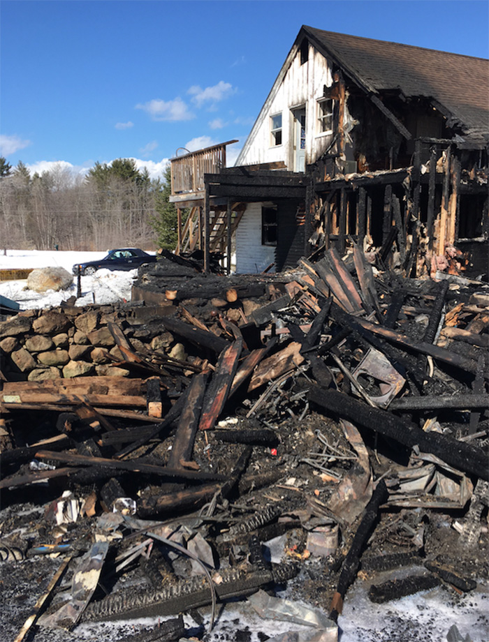 A two-story barn was destroyed and an attached farmhouse made uninhabitable by a fire Sunday on Foxes Ridge Road in Acton.
