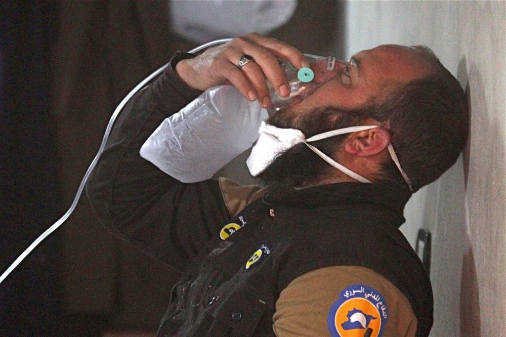 A Syrian civil defense member breathes through an oxygen mask after what rescue workers say was a gas attack in the town of Khan Sheikhoun in rebel-held Idlib.