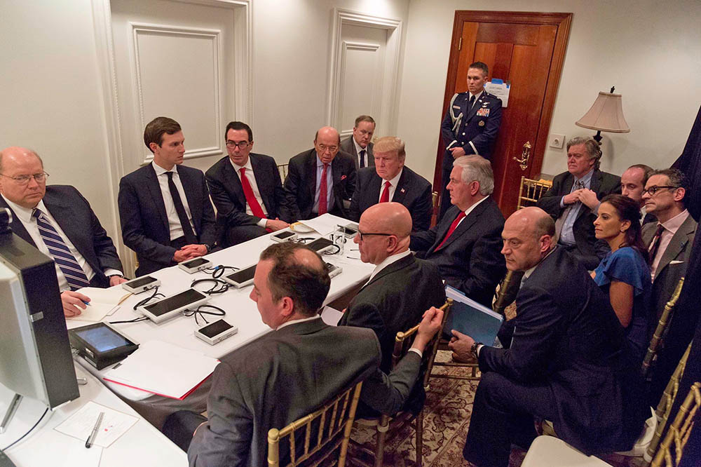 President Trump and his  national security team are briefed via videoconference by Gen. Joseph Dunford, chairman of the Joint Chiefs of Staff, on the missile strike on Syria. The meeting took place in the Sensitive Compartmented Information Facility at Trump's Mar-a-Lago resort in West Palm Beach. White House Press Secretary Sean Spicer said the image was digitally edited for security purposes.