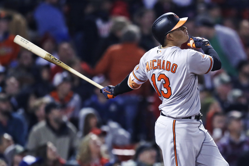 The Orioles' Manny Machado watches the flight of his solo home run in the sixth inning.