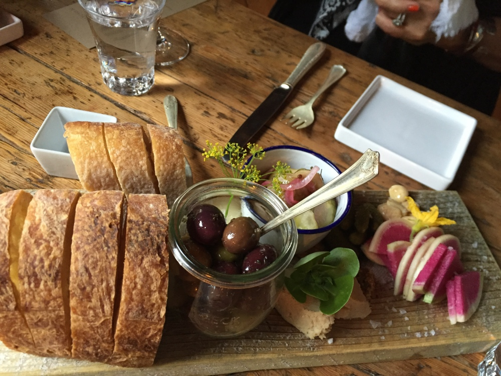 Bread, olives and other nibbles are served at The Lost Kitchen in Freedom before the meal begins.