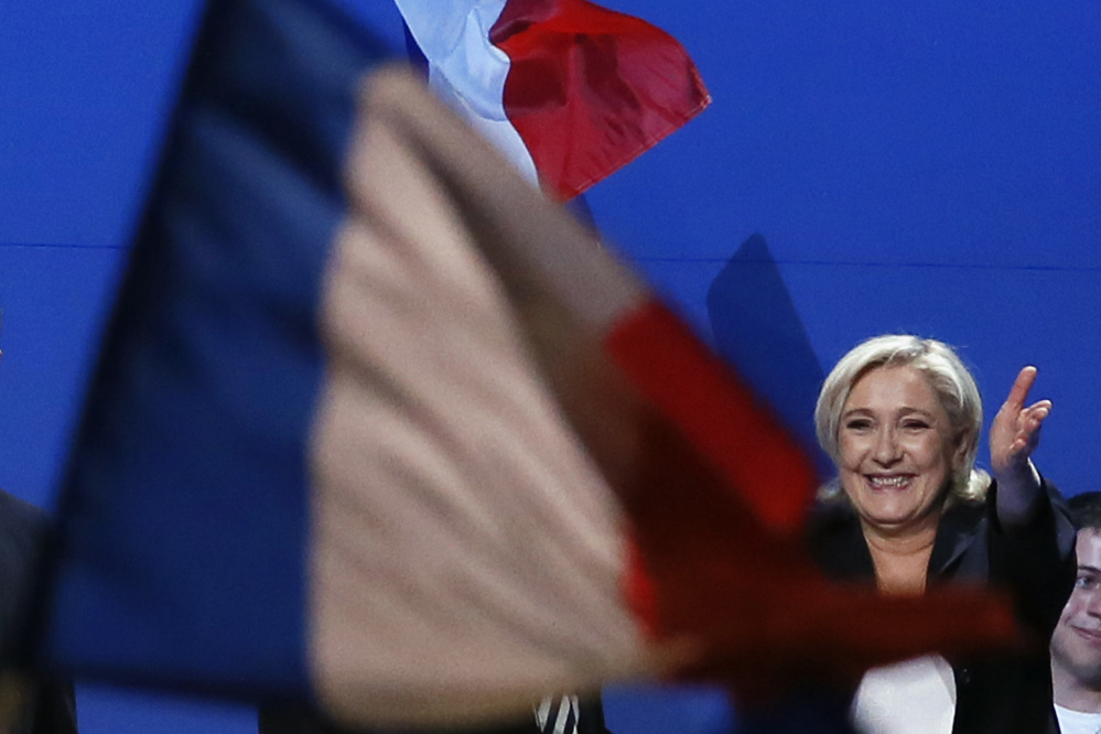 French far-right presidential candidate Marine Le Pen waves to supporters during her meeting, Monday May 1, 2017, in Villepinte, outside Paris. With just six days until a French presidential vote that could define Europe's future, far-right leader Marine Le Pen and centrist Emmanuel Macron are holding high-stakes rallies Monday. (AP Photo/Francois Mori)