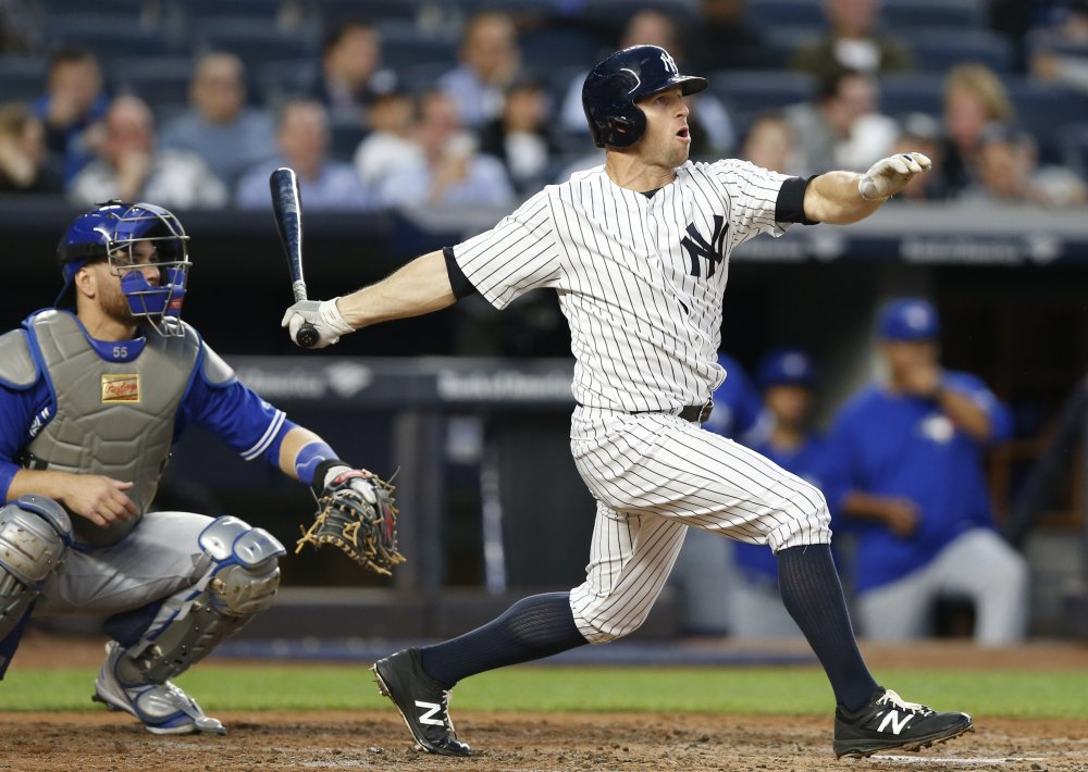 Brett Gardner watches his two-run home run off Toronto's Mat Latos in the second inning Tuesday night in New York. Gardner also hit a homer in the fourth inning of an 11-5 Yankees' win.