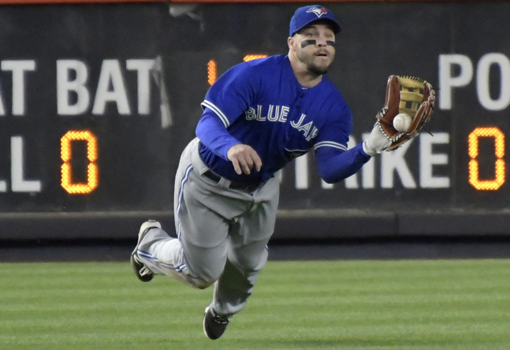 Blue Jays left fielder Steve Pearce makes a catch on a ball hit by Chase Headley of the Yankees during the fifth inning of New York's 8-6 victory over Toronto on Wednesday night at Yankee Stadium.