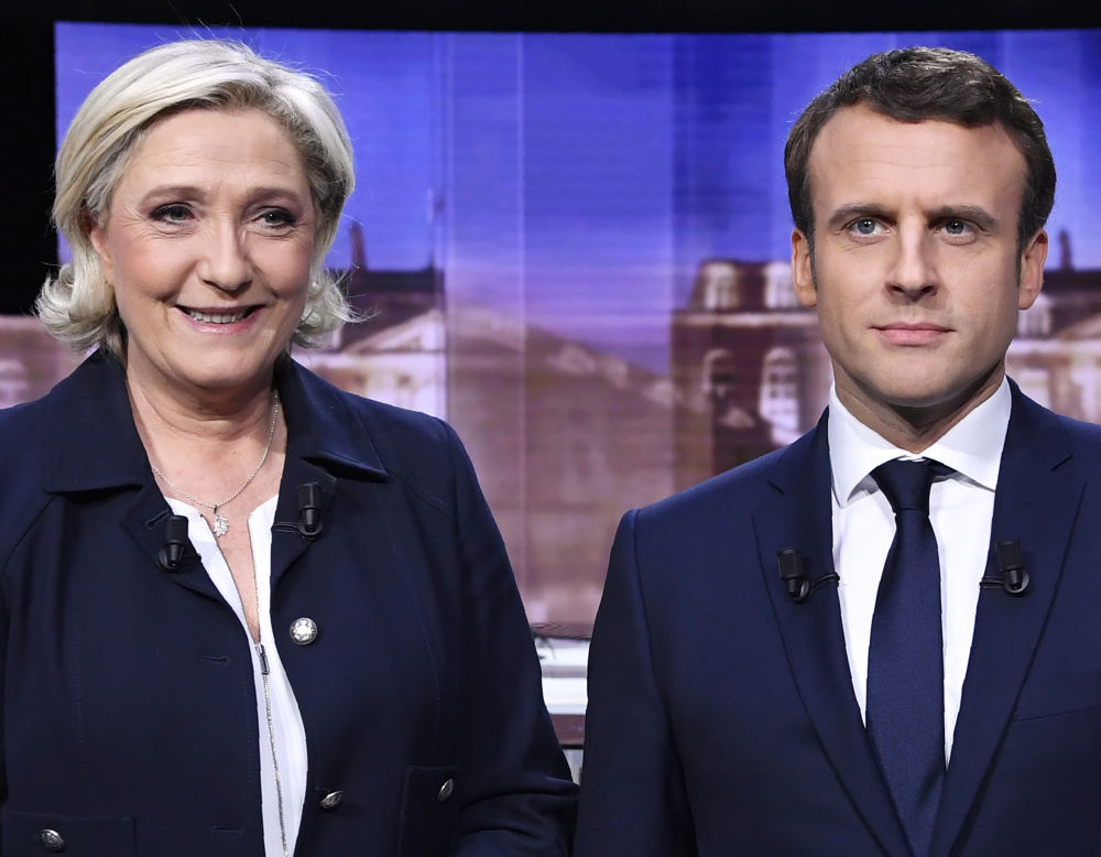 French presidential election candidates Marine Le Pen and Emmanuel Macron meet for a debate Wednesday.