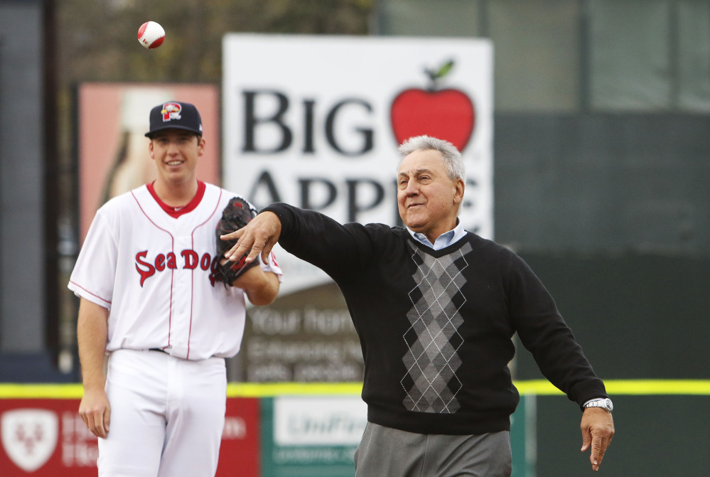 With pitcher Teddy Stankiewicz looking on, Rico Petrocelli, the former Red Sox infielder, delivers the first pitch Thursday night at Hadlock Field prior to the Portland Sea Dogs' game against the Reading Fightin Phils.