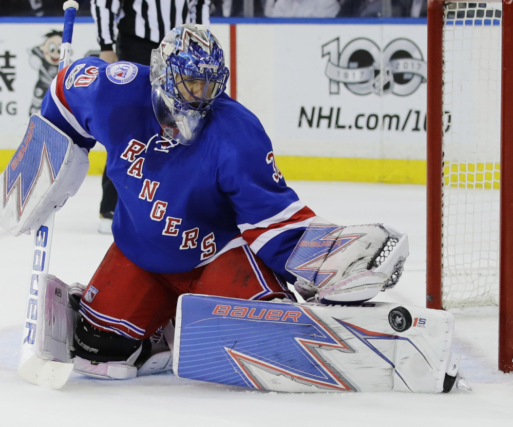 Rangers goalie Henrik Lundqvist makes one of his 22 saves Thursday against Ottawa in Game 4 of their Eastern Conference semifinal series. The Rangers won 4-1, evening the series at 2-2.