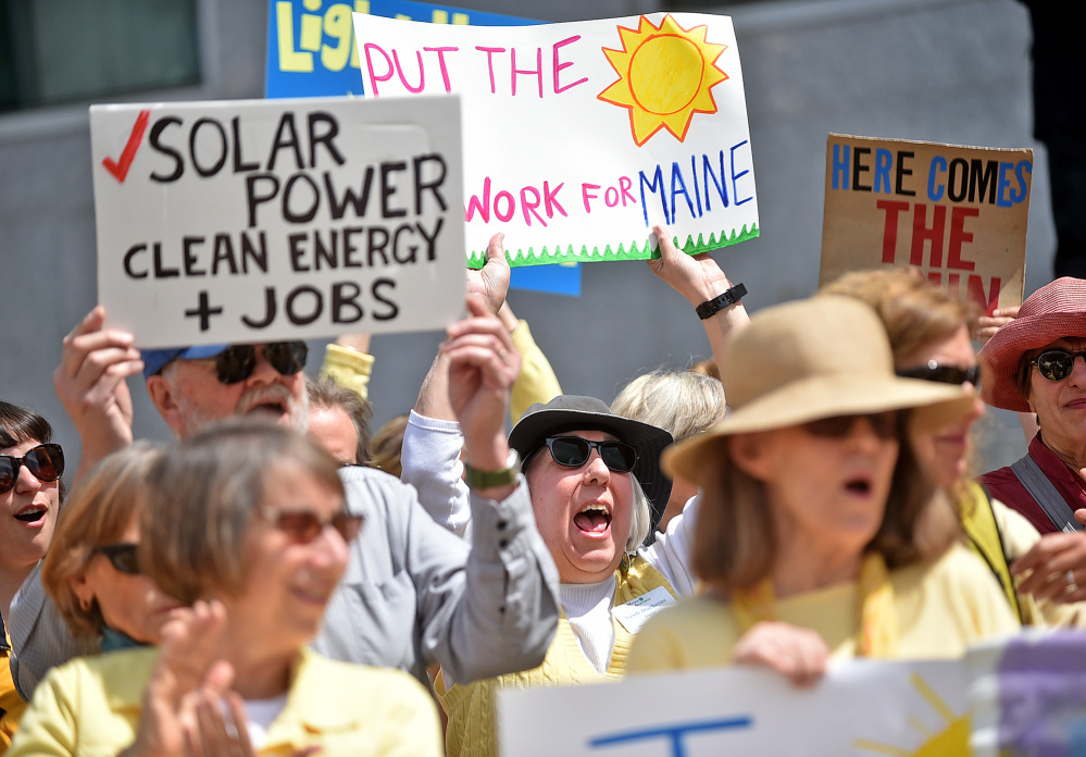 Advocates of clean energy rally on Thursday at the Burton M. Cross Building in Augusta, where opponents and supporters of financial incentives for solar power spoke at a public hearing. Lawmakers are considering a bill that would restore certain incentives recently reduced by regulators. The competing claims will be weighed in upcoming work sessions.