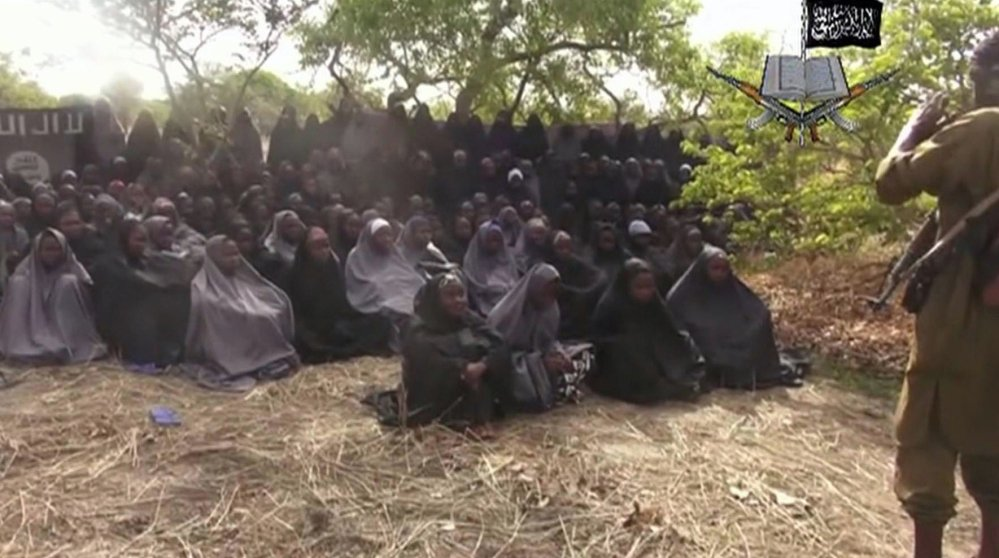 This 2014 image taken from video by Nigeria's Islamic extremist network purports to show schoolgirls abducted from the northeastern town of Chibok. The mass abduction shocked the world, sparking a global #Bringbackourgirls campaign.