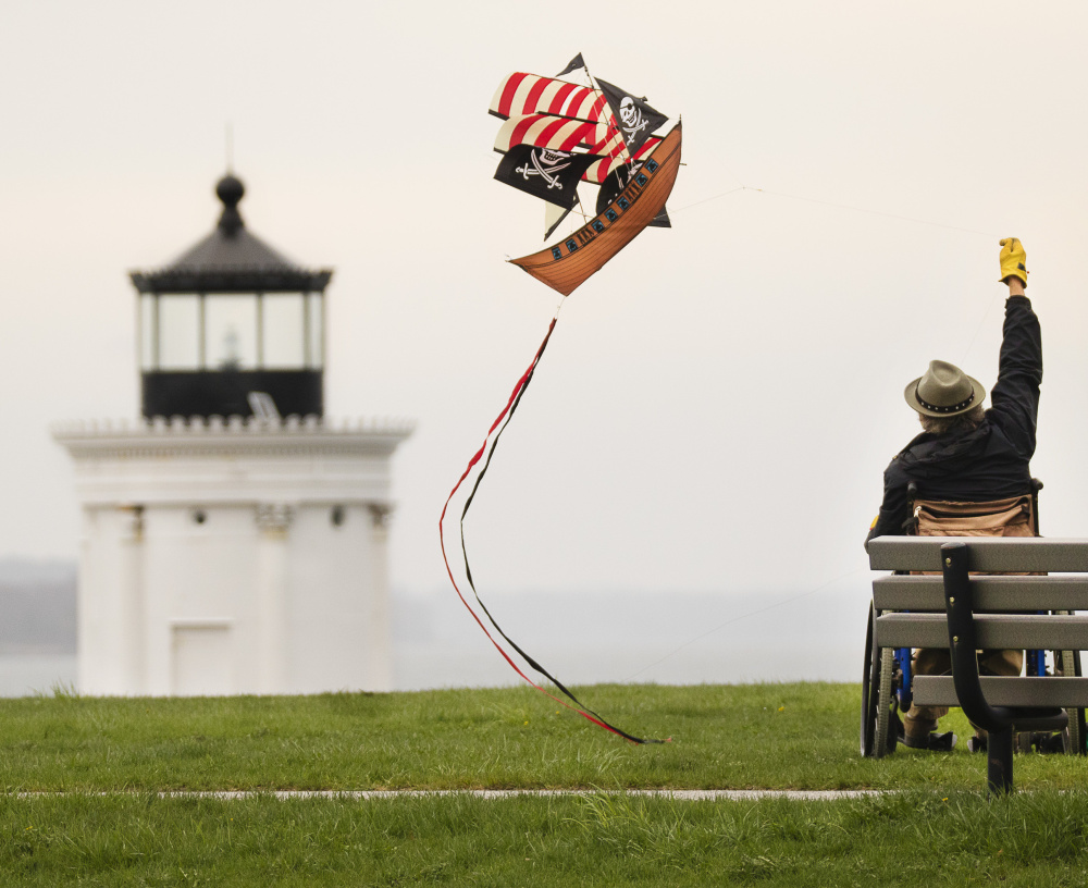 Dave Hunt of Dresden flies a kite at Bug Light Park in South Portland on Sunday. Starting May 20, licensed food trucks can be at the park to serve visitors from 8 a.m. to 8 p.m. near the Bug Light.