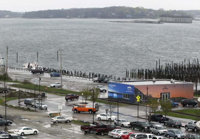 Plans call for the city-owned parking lot near the water, at top left, to become a waterfront park, and for other under-used space in the area to hold new multistory buildings that would include housing.